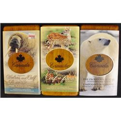 Lot of Three Limited Edition Stamp and .999 fine Silver coin set with wood case.