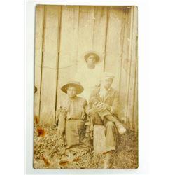 BLACK AMERICANA RPPC REAL PHOTO POSTCARD OF A FAMILY
