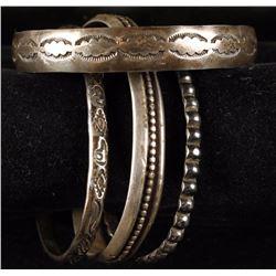 Collection of 4 Sterling Navajo Bracelets