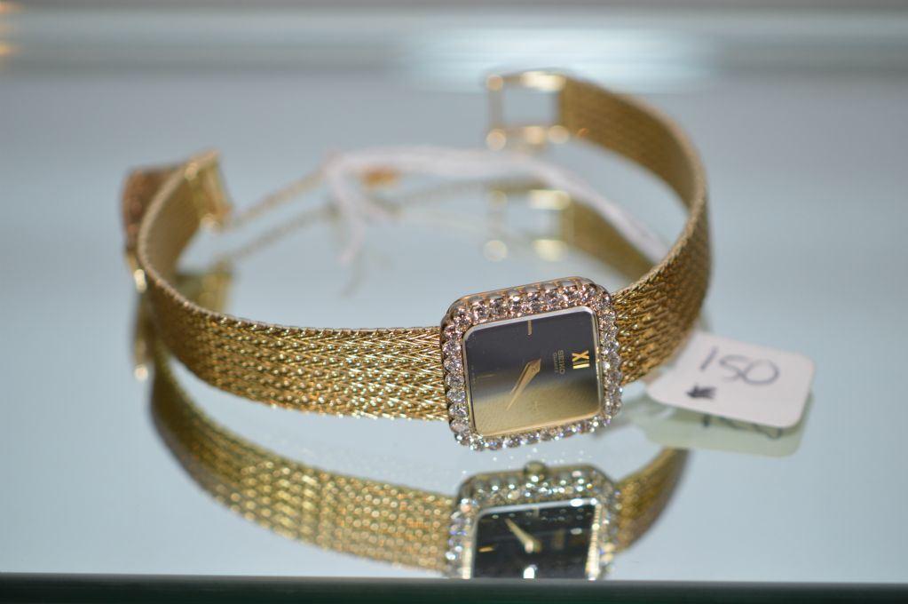 Lady's 14kt yellow gold Seiko wrist watch with 32 brilliant