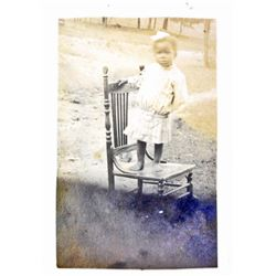 BLACK AMERICANA RPPC REAL PHOTO POSTCARD OF A LITTLE GIRL STANDING ON A CHAIR