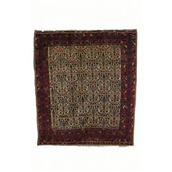AN AFSHAR RUG, south Persian, c.1920, a floral lattice in red, blue and light blue on an ivory fi...