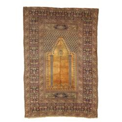 A SILK TURKISH PRAYER RUG, early 20th century, an open gold field with hanging lanturn within two...