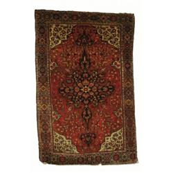 A SAROUK FEREGHAN RUG, west Persia, c.1900, a multi lobed pendant medallion a floral filled pale...