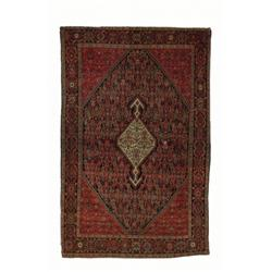A MALAYER RUG, west Persia, c.1900, a double lobed ivory ground lozenge medallion on a midnight b...