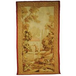 A FRENCH TAPESTRY, c.1850, a pictoral scene of a bulding beside a river in shades of green, brown...