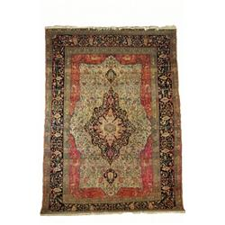 A KASHAN CARPET, early 20th century, a double lobed blue and ivory ground pendant medallion on an...