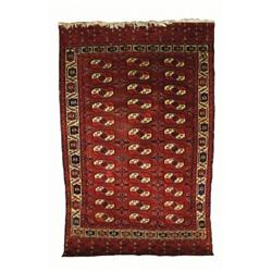 A YOMUD MAIN CARPET, West Turkestan, late 19th Century, the claret field containing 36 guls in bl...