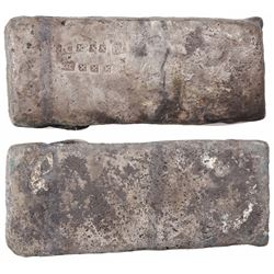 "Small, thick, brick-like ""tumbaga"" silver bar #1128, 2395 grams, marked with assayer/owner B~Vo, ser"