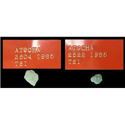 Lot of 2 small, natural emeralds, 1.57 and 1.16 carats, both with original plastic tags but only one