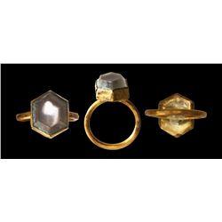 Gold ring with bluish quartz stone (hexagonal cut).