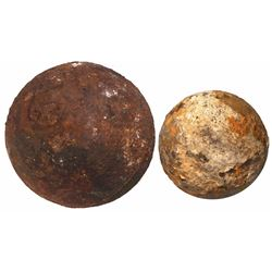 Lot of 2 small iron cannonballs (one broken off a barshot), encrusted with coral.