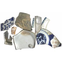Lot of porcelain and pottery shards, plus a tiny lead musketball.