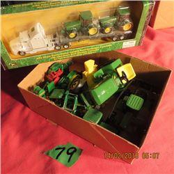Box of miniature tractors and 1/87 scale semi