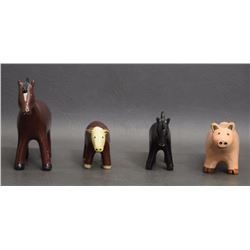 FOUR POTTERY ANIMALS (MANNYGOATS)