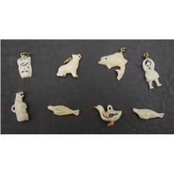 EIGHT IVORY CHARMS