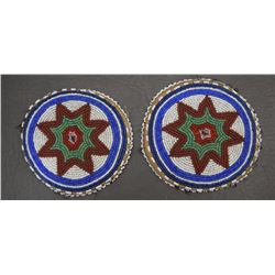 TWO PLAINS BEADED ROSETTES