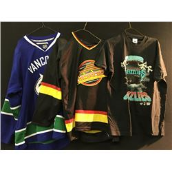 2 VANCOUVER CANUCK JERSEYS AND A VANCOUVER GRIZZLIES T-SHIRT