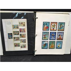 ALBUM FULL OF NEWS ARTICLES AND DISNEY STAMPS