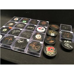 LARGE LOT OF OVER 50 SIGNED HOCKEY PUCKS INC: LUONGO, LACK, FERRARO, GARRETT,