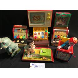 COLLECTION OF ASSORTED VINTAGE TOYS INC: 3 SLOT MACHINES, TOY T.V., RABBIT, CLOWN JACK IN THE BOX,