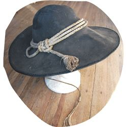 Mike's western hat with rawhide band and stampede string