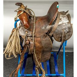 Old, Worn Saddle with Bridle and Lariat