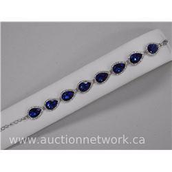 Ladies Chic Custom Fancy Bracelet - 8 Pear Shape Sapphire Blue Swarovski Elements with Bead Setting