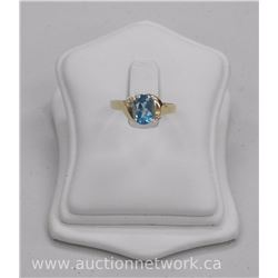 Ladies 10kt Gold Oval Topaz Solitaire Ring with 2 Side Diamonds. (1.18ct) tw. Size 6.5. SRRV: $1600.