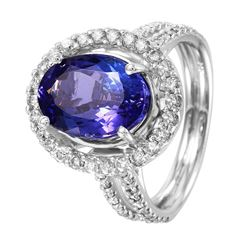 14KT White Gold Tanzanite and Diamond Ring - #1530