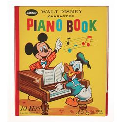 """Walt Disney Character Piano Book""."