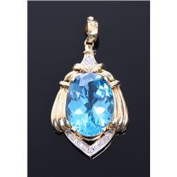 Huge 28.79 carat blue topaz and 0.14 carat diamond pend
