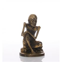 A 19th Century bronze/brass figure of a skinny Luohan.