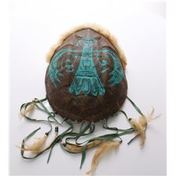 Native American painted turtle shell adorned with fur,