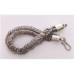 Native American custom made sterling silver loop bracel