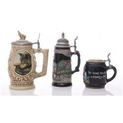 Three(3) Stein mugs.  Two made in Germany and one made