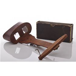 Antique wooden stereoscope viewer with a box of slides