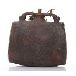 19th Century wood pilgrim's flask with oval, black-smit