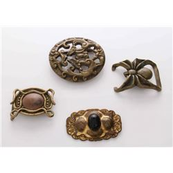 A collection of four (3) vintage belt buckles and an an