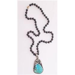 Native American sterling silver and turquoise pendant o