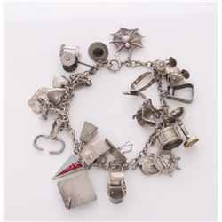 Vintage sterling silver charm bracelet.  Condition Repo