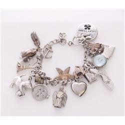 Vintage sterling silver charm bracelet.  Report: Some c