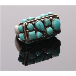 A unique Native American sterling silver and turquoise
