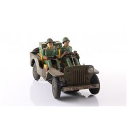 Vintage Army jeep tin toy.  SIZE: see attached ruler ph