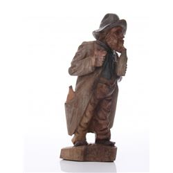 Antique wood carving of a man drinking from a bottle, E