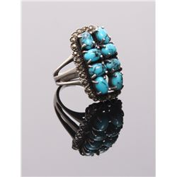 Eight stone cluster of turquoise stone mounted with a p
