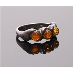Antique sterling silver ring with amber stone setting.