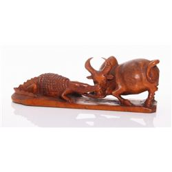 Gator biting a bull, wood carving. African, 20th Centur