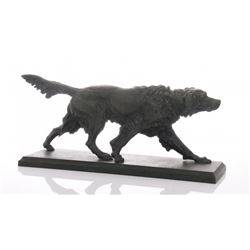Antique metal sculpture of a hunting dog with green pat
