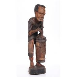 Vintage African carved wood sculpture of a drummer.  SI